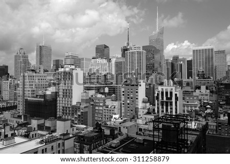 A view of buildings in midtown Manhattan in black and white.