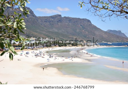 A view of Camps Bay Beach in Cape Town, South Africa, with the Twelve Apostles in the background. - stock photo