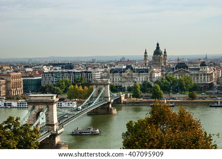 A view of chain bridge in Budapest, with St. Stephen's basilica in background