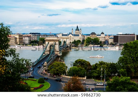 A view of chain bridge in Budapest, with St. Stephen's basilica in background - stock photo