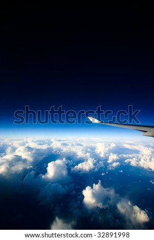 A view of clouds from an airplane window - stock photo