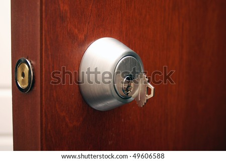 A view of deadlocked wooden door. - stock photo