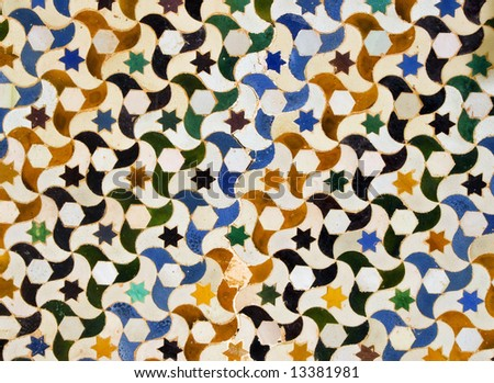 A view of decorative ceramic artwork found on a wall at the Alhambra castle in Granada, Spain.  Suitable for an abstract background.
