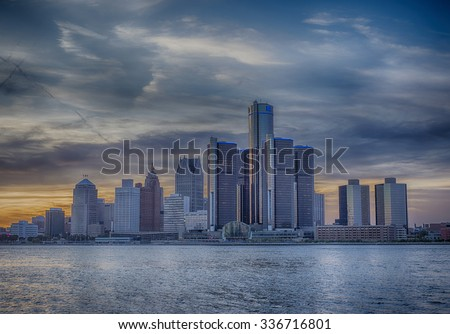 A view of Detroit skyline at sunset with dramatic HDR effect - stock photo