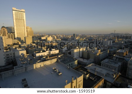 A view of downtown San Francisco looking east as the last rays of sun catch the hotels around union square - stock photo