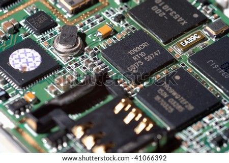 A view of electronic circuit (inside the mobile phone), some components on it. - stock photo