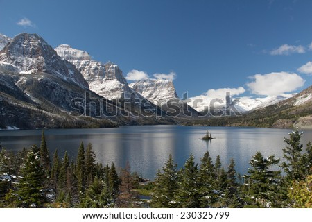 A view of Goat Island in St Mary's Lake in Glacier National Park - stock photo