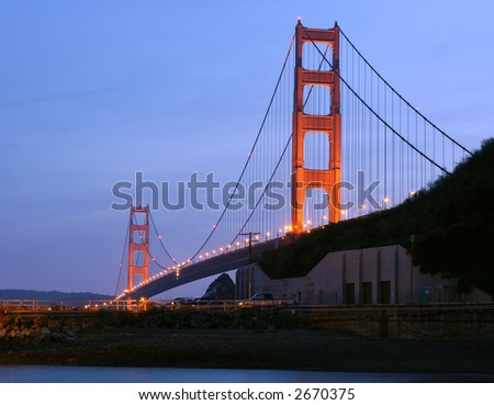 A view of Golden Gate Bridge at dusk from the harbor at Fort Baker, Sausalito, California.
