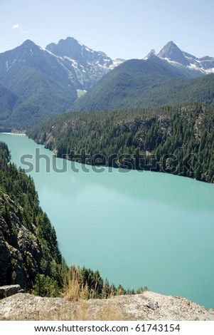 A view of green glacier lake. - stock photo