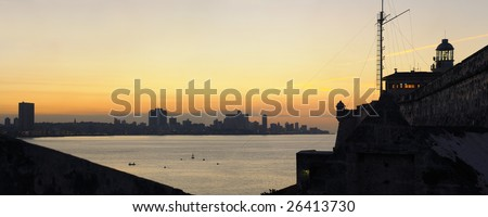 "A view of Havana bay and skyline at sunset from spanish fortress ""El Morro"" - stock photo"