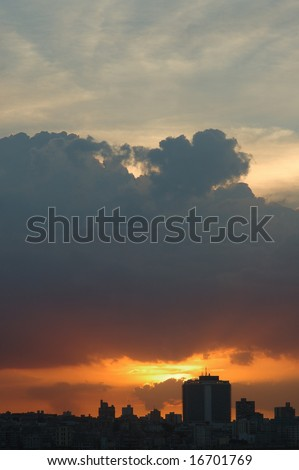 A view of Havana skyline at sunset with big dramatic clouds - stock photo