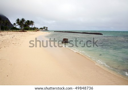 A view of Honolulu beach in Hawaii in fog and windy day. - stock photo