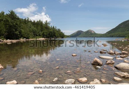 A view of Jordan Pond and the Bubbles Peaks in the distance.