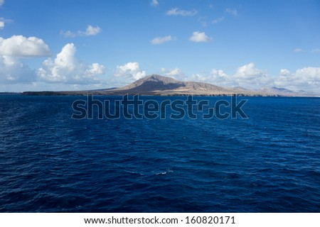 A view of Lanzarote, Canary Islands, from the ferry in the middle of the Atlantic Ocean. - stock photo