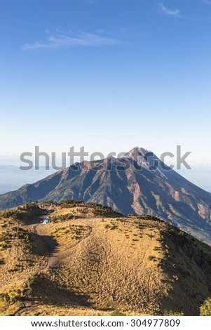 A view of Merapi volcano from the Merbabu volcano near the touristic city of Yogyakarta  in central  Java in Indonesia