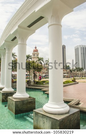 A view of Merdeka Square in Kuala Lumpur through white columns - stock photo