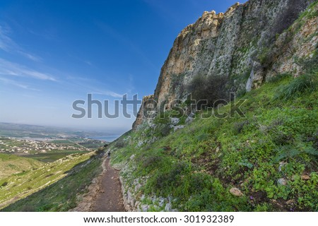 a view of Mount Arbel  Cliff Cave Fortress overlooking the Sea of Galilee and Golan Heights - stock photo
