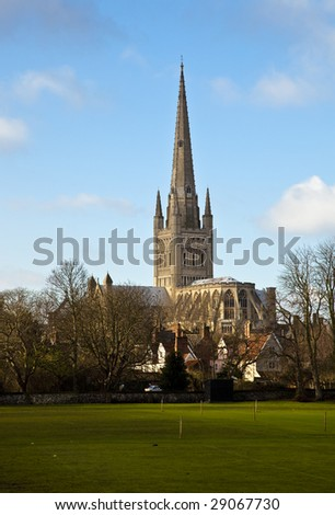 A View of Norwich Cathedral from across the playing fields - stock photo