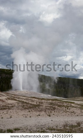 A view of Old Faithful geyser at Yellowstone National Park. - stock photo