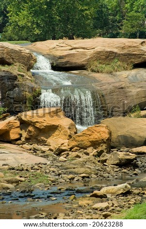 A view of part of the waterfall at Falls Park at Reedy River in Greenville, SC. - stock photo