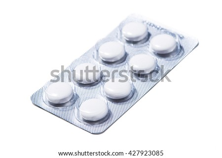 A view of pills in blister isolated against white background - stock photo