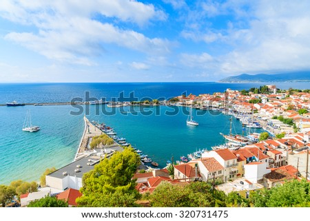 A view of Pythagorion port with colourful houses and blue sea, Samos island, Greece - stock photo
