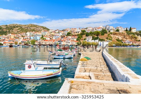 A view of Pythagorion port with traditional colourful Greek fishing boats, Samos island, Greece - stock photo