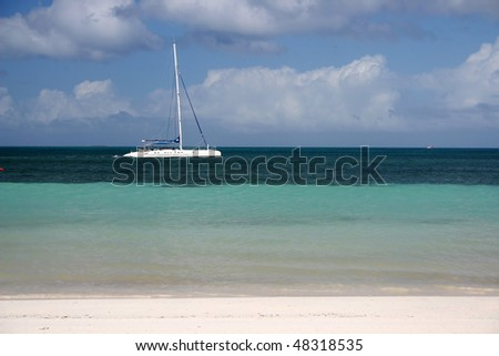 A view of sailing boat and beach in Cuba.