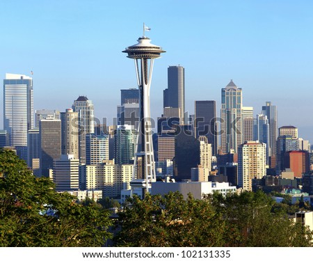 A view of Seattle Washington modern skyline buildings and mt. Rainier.