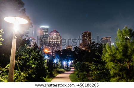 A view of skylines Houston with a path leading line of Bay You trail