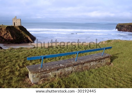 a view of snow covered ballybunion beach in winter with concrete bench - stock photo