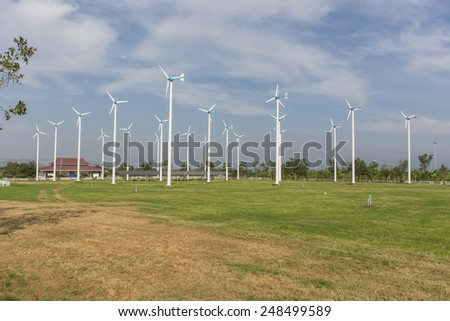 A View of Solar Panels and Wind Turbine in the Field at Chang-Hua-Mun, Royal Initiative Project, Huahin Thailand. - stock photo