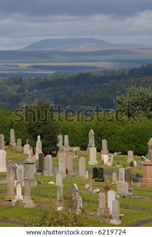 A view of Stirling cemetery under a cloudy sky, Scotland