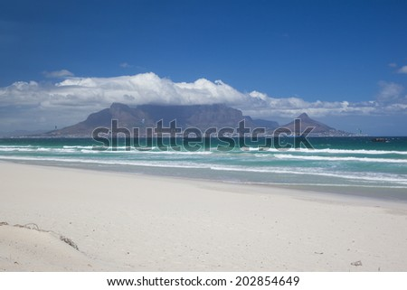 A View of Table Mountain and the City of Cape Town, South Africa. Seen from Blouberg Strand on a Hot Summers Day. - stock photo