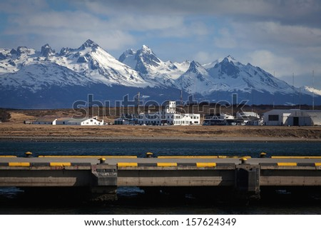 A view of the airport of Ushuaia, Tierra del Fuego. Boats line t - stock photo