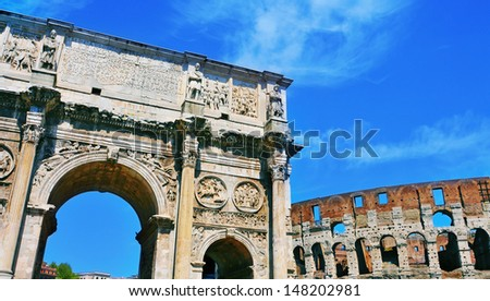 a view of the Arch of Constantine and the Coliseum in Rome, Italy - stock photo