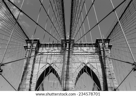 A view of the arches of Brooklyn Bridge in NYC in black and white