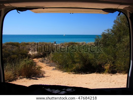 A view of the beach and ocean from the back of a camper van. Monkey Mia - Western Australia - stock photo
