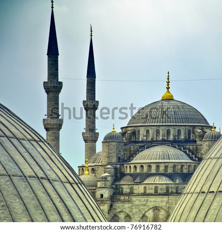 A view of the blue mosque from a window of the hagia sophia in the turkish city of Istanbul. - stock photo