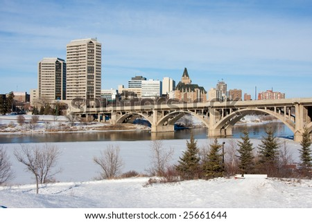 A view of the Broadway Bridge and downtown Saskatoon, Canada on a sunny day in winter. - stock photo
