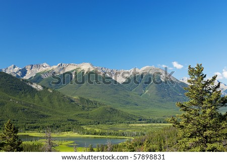 A view of the Canadian Rockies, showing Vermillion Lakes; with text space. - stock photo