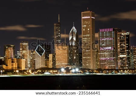 A view of the Chicago skyline at night on a cloudy day.