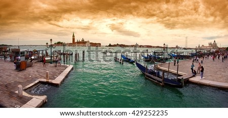 A view of the Church of San Giorgio Maggiore on the island of the San Giorgio Maggiore with gondolas parked in the water canal on Riva degli Schiavoni in Venice, Italy. - stock photo