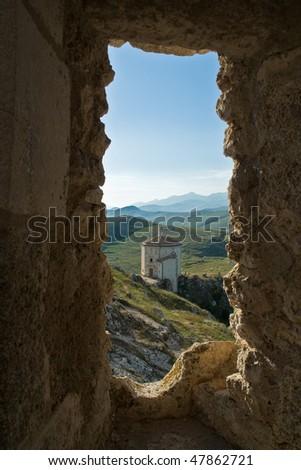 """A view of the Church of """"Santa Maria della Pieta'"""" from Rocca Calascio castle. - stock photo"""