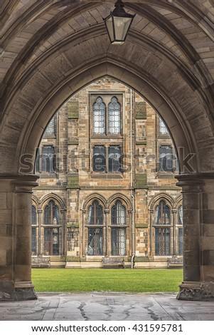 A view of the courtyard at Glasgow university through one of the many arches that are part of the main victorian building. - stock photo