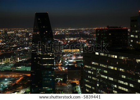 A view of the Dallas night scape from on top of a high rise. - stock photo