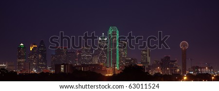 A view of the Dallas Skyline from the West at dusk, just after sunset. - stock photo