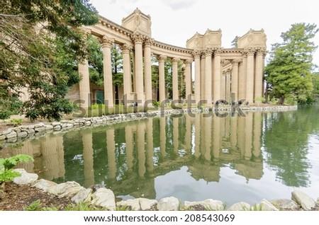 A view of the dome rotunda of the Palace of Fine Arts in San Francisco, California, United States of America. A colonnade roman greek architecture with statues and sculptures build around a lagoon. - stock photo