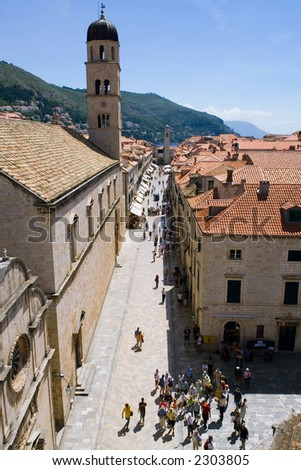 A view of the Dubrovnik main street and its Franciscan Monastery - stock photo