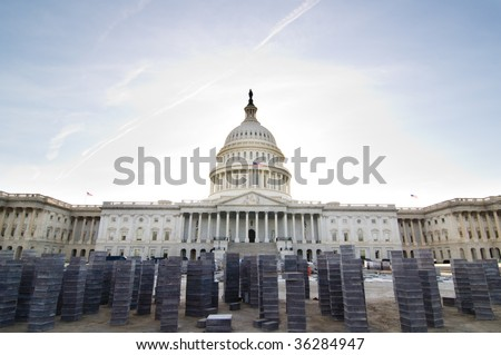 A view of the east steps of the United States Capitol Building, where paving stones are stacked for construction.